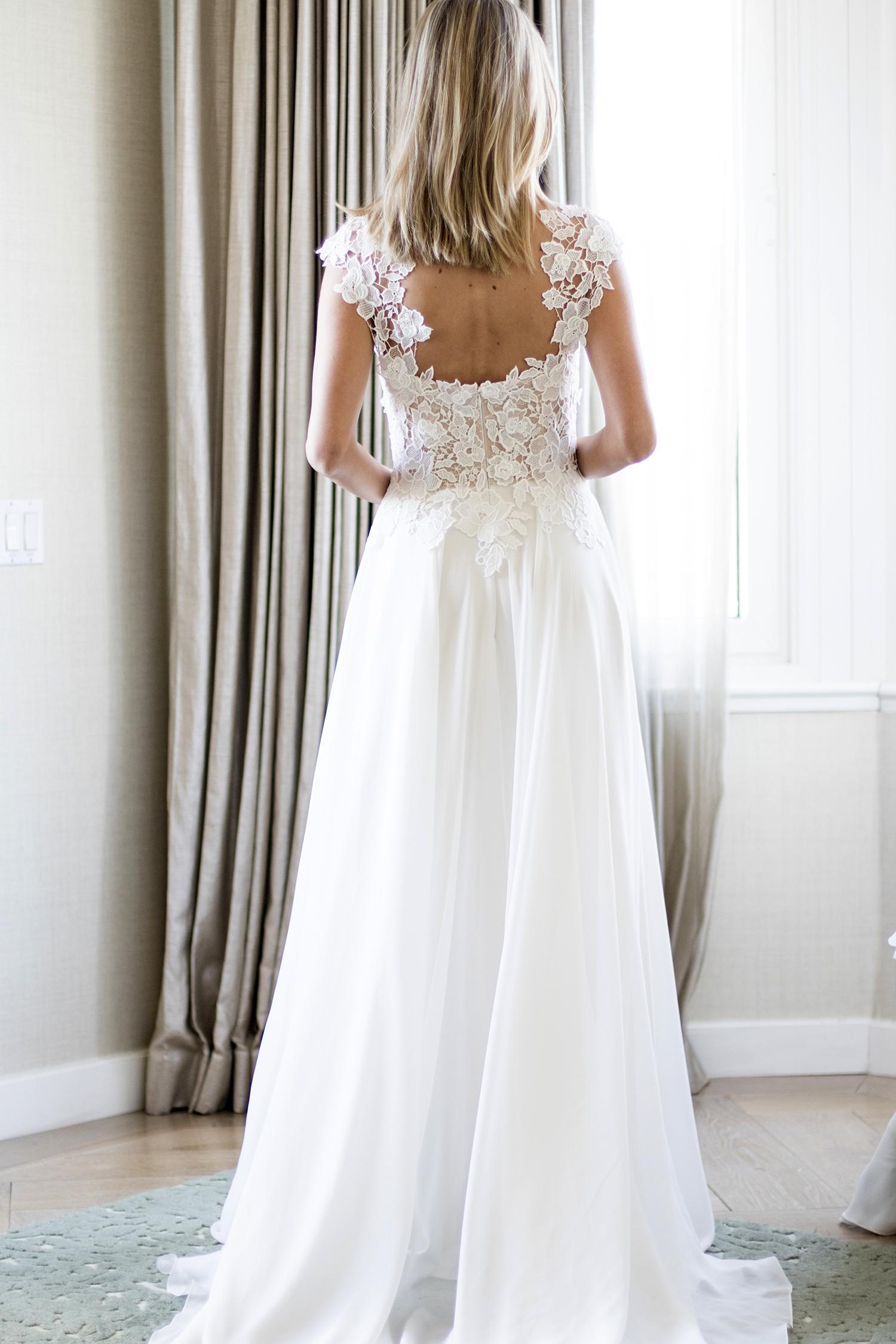 Morning back detail designer wedding dresses by Caroline Castigliano
