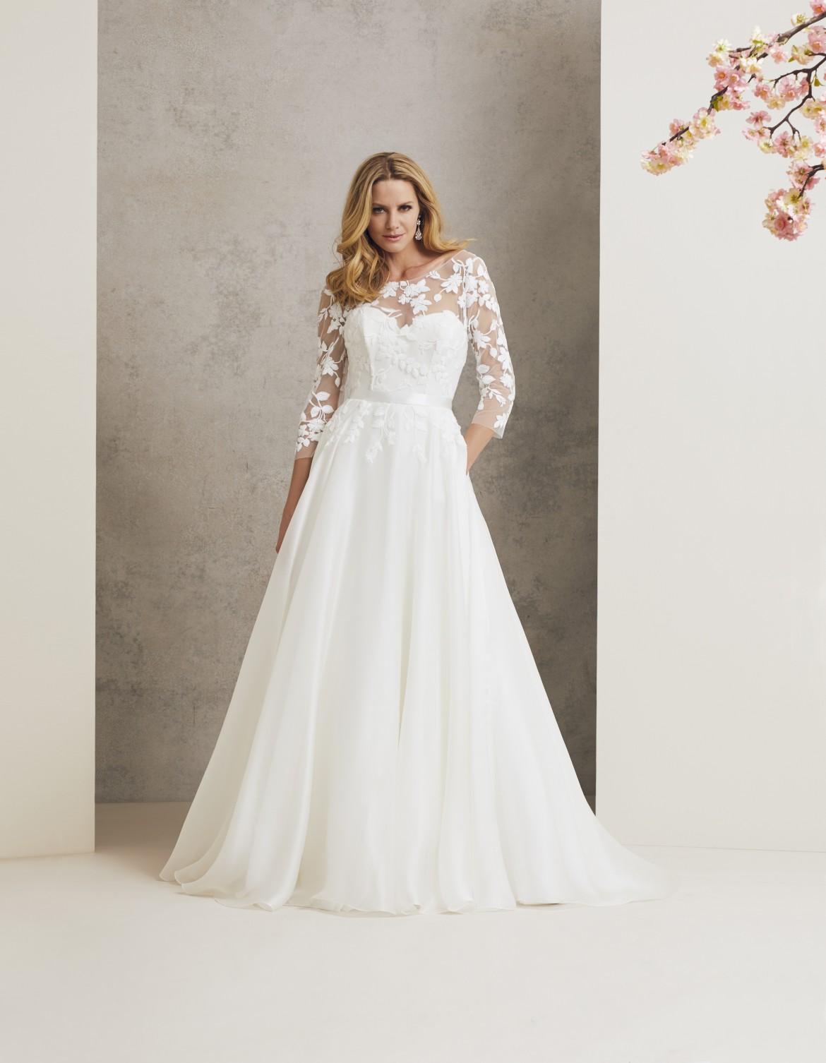 Burgundy designer wedding dress by Caroline Castigliano