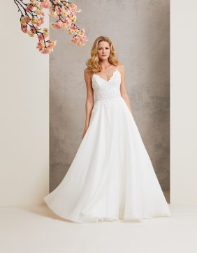 Four Seasons designer wedding dress by Caroline Castigliano